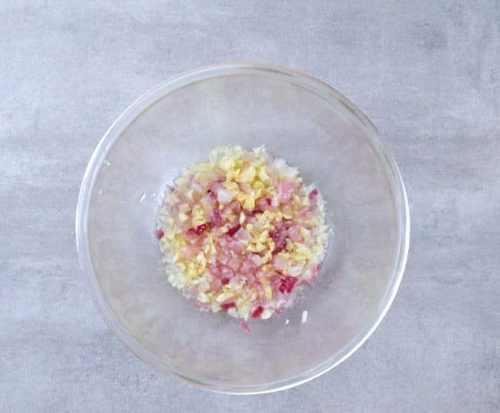 Place the oil, garlic and onion in a large bowl and microwave for 3 minutes