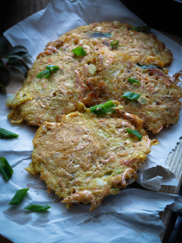Ukoy is a Filipino version of Shrimp Fritters. It is usually eaten as a Filipino appetizer or snacks but my family have it breakfast, lunch and dinner. Made mostly with Shrimps and mixed with simple batter to bind the ingredients.  Ukoy will be a perfect meal for you to try. I know it can be intimidating to make due to the baby shrimps, but try it once dip in homemade sauce and it will satisfy your curiosity.
