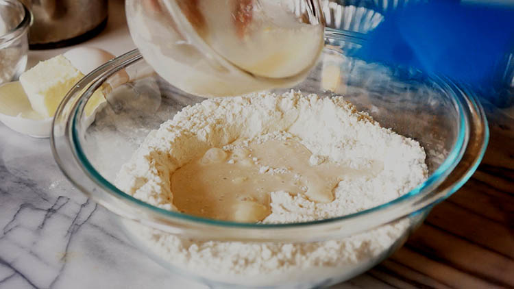 Form a well and add the yeast mixture