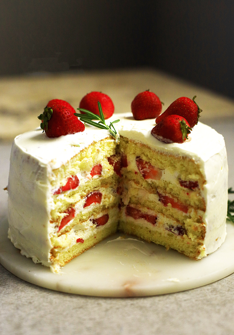 Easy and simple 4 Ingredient Layer Sponge Cake strawberry shortcake with whipped cream and slice strawberries. Make this for birthdays or any occasions and you will surely please the crowd.