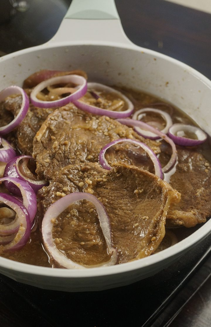 Bistek Tagalog is a Filipino version of beef steak. It has citrus flavor and a mixture of salty and sweet taste. It's a cheap version of beef steak.